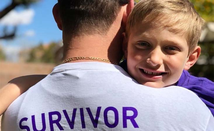 Pancreatic cancer survivor with young son at PurpleStride Las Vegas fundraiser