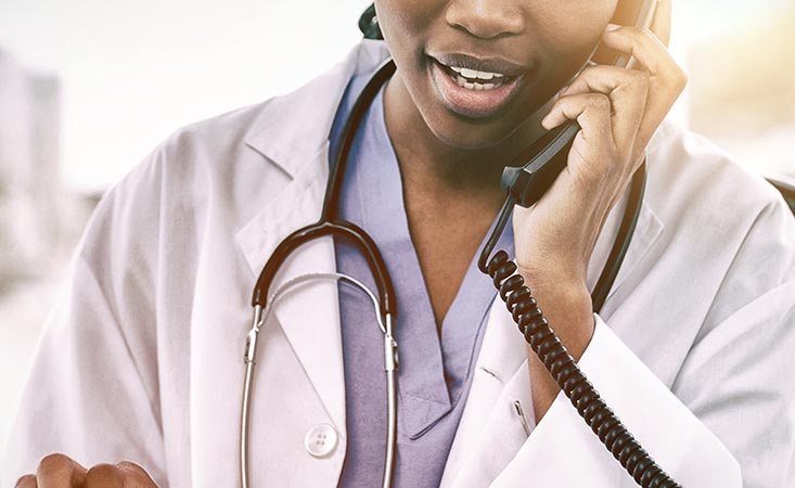 Using telemedicine, a doctor answers her pancreatic cancer patient's questions over the phone