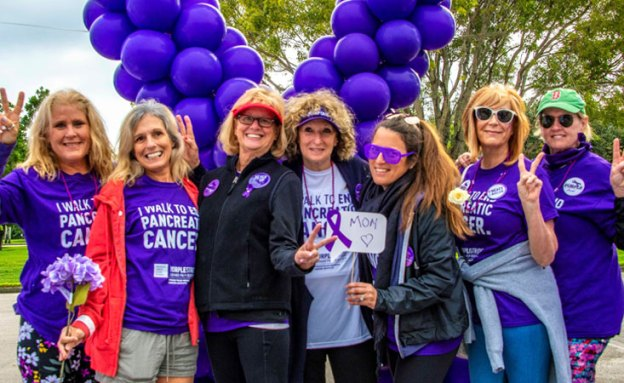 Pancreatic cancer survivor Reesa Levy at PanCAN's PurpleStride (center)