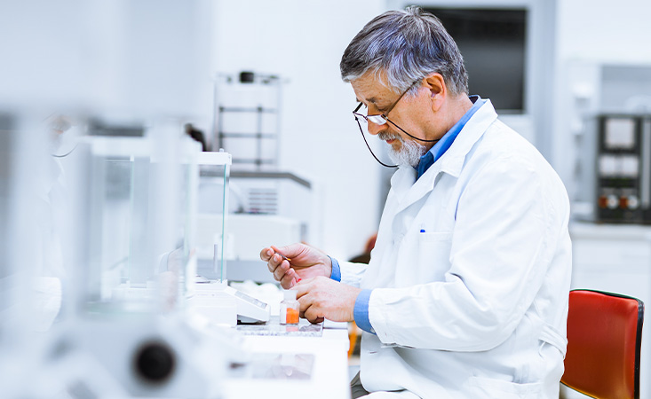 Pancreatic cancer researcher examining blood sample