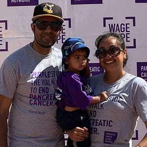 Woman, man, and toddler at San Francisco PurpleStride.
