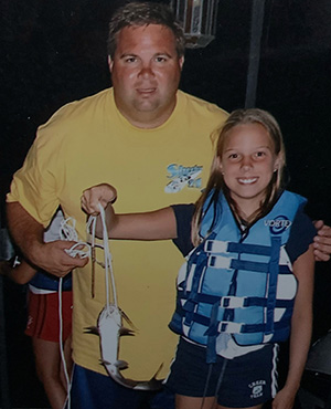 Young Melissa fishing with her father
