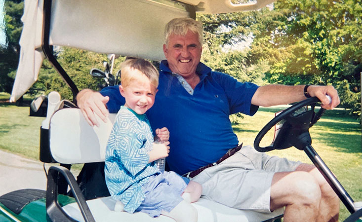 A young Matt Ernst is shown with his grandfather, Pete Carpenter