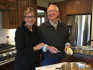 Renowned pancreatic cancer oncologist with her husband relax in the kitchen