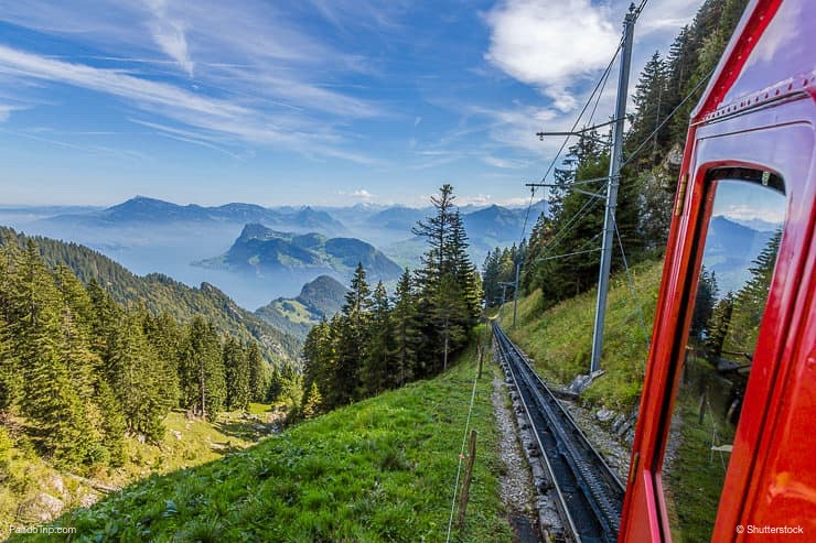 The Pilatus train, the world's steepest cogwheel railway nears the top of Mount Pilatus as it emerges from the clouds