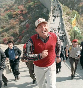 Venezuelan President Hugo Chavez, wearing a Great Wall cap, tours a section of the Great Wall of China, north of Beijing, Monday, Oct. 11, 1999. Chavez visited the wall before his official welcome ceremony with Chinese President Jiang Zemin later in the day. (AP Photo/Xinhua)