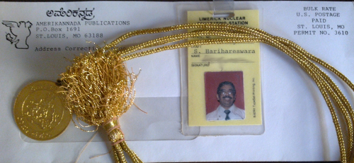 An Amerikannada envelope, my dad's employee badge at a nuclear power station, and the Rajyotsava award he received for service to the Kannada language