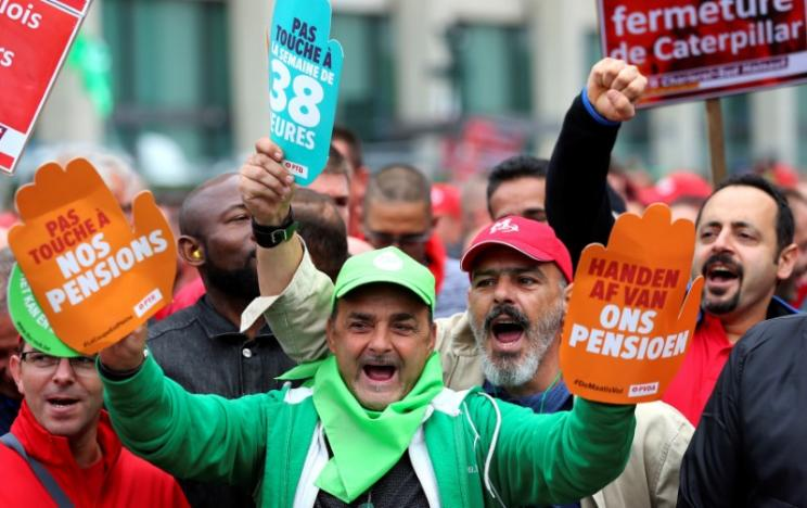 Trade union members march downtown during a protest over the government's reforms and cost-cutting measures in Brussels
