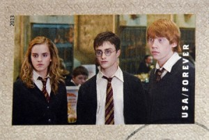 27028704 - united states of america - circa 2013: a stamp printed in usa dedicated to harry potter shows hermione granger, harry potter, and ron weasley, circa 2013