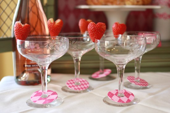 paper and cake behind the tablescape strawberry heart garnishes
