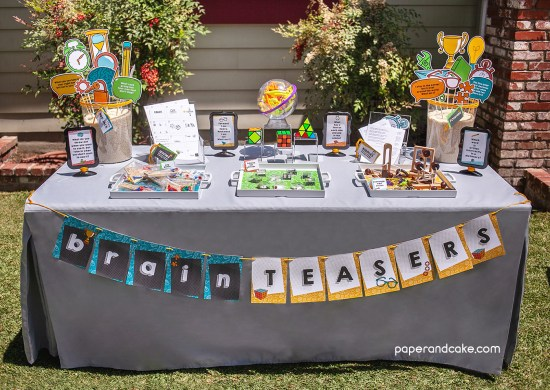 birthday party table with activities and decorations on top