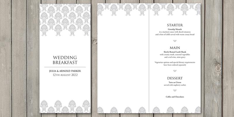 Stand wedding menus onto the wedding breakfast table.
