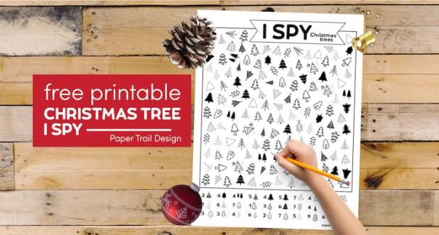 Christmas tree themed I spy activity with kid's hand holding pencil with text overlay- free printable Christmas tree I spy