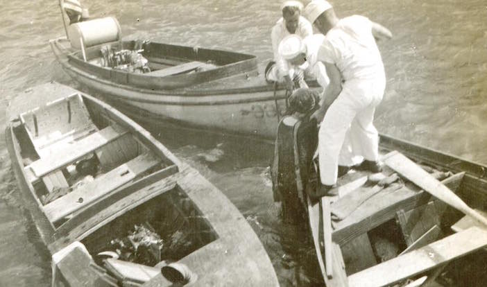 American sailors pulling a victim from Smyrna harbor.