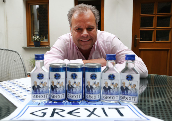 epa04816115 47-years old German businessman Uwe Dahlhoff poses behind products labeled with 'Grexit' in Hamm, Germany, 23 June 2015. Next week Dahlhoff wants to roll out a lemon vodka liqour with the brand name 'Grexit'. The term Grexit refers to the possibility that Greece leaves the Eurozone and combines Greece and exit.  EPA/INA†FASSBENDER