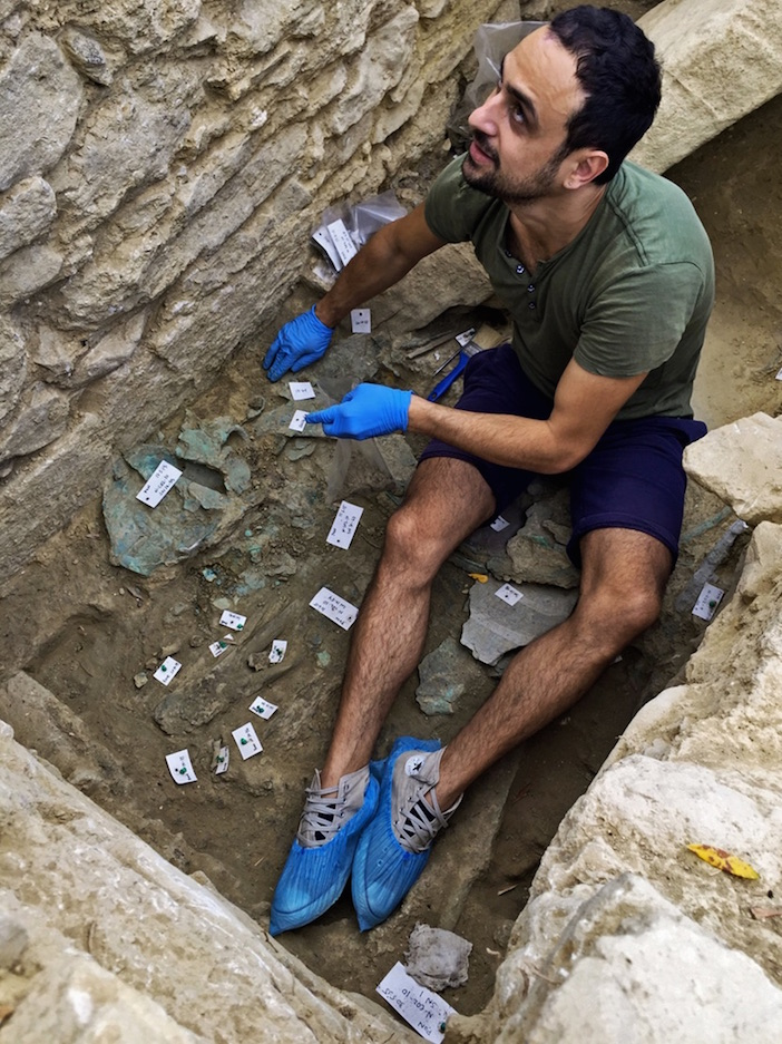 Alex Zokos, a conservator, removed a bronze jug at the site. (Photo: Department of Classics/University of Cincinnati)