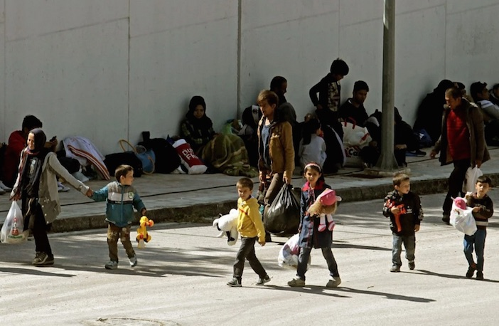 Refugees and migrants arrive at the Galatsi Olympic Hall near Athens. (Alexandros Vlachos/EPA)