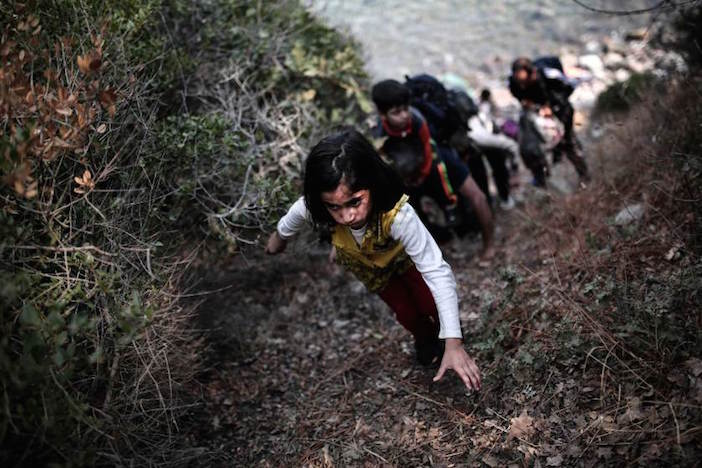 One of Angelos Tzortzinis' award-winning photos: A child tries to climb a slope after arriving on the shores of the Greek island Lesbos in an inflatable dingy across the Aegean Sea from from Turkey on September 3, 2015. More than 230,000 refugees and migrants have arrived in Greece by sea this year, a huge rise from 17,500 in the same period in 2014, deputy shipping minister Nikos Zois said.AFP PHOTO / ANGELOS TZORTZINIS (Photo credit should read ANGELOS TZORTZINIS/AFP/Getty Images)