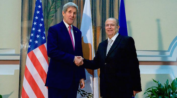U.S. Secretary of State John Kerry shakes hands with Cyprus Foreign Minister Ioannis Kasoulides on December 3, 2015, after arriving at the Ministry of Foreign Affairs in Nicosia, Cyprus, for a bilateral conversation amid meetings with both Greek and Turkish leaders on the island nation.
