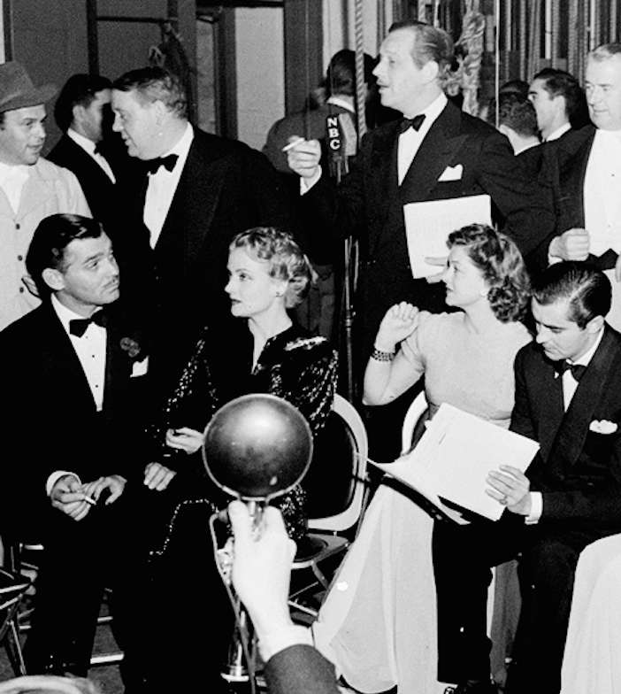 Some of the top line Hollywood personalities who participated in the gigantic, all-star Greek War Benefit Broadcast heard over the NBC network, Saturday, February 8, 1941. Left to right: at top, Charles Laughton, Melvyn Douglas, Reginald Owen, Lewis Stone; and seated, Clark Gable, Carole Lombard, Myrna Loy, Tyrone Power, Ann Rutherford, and Fay Holden. Broadcast by NBC from Grauman's Chinese Theatre, the program was also taken by mutual and several local Los Angeles stations.