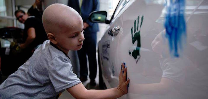 Chris Ellis places his handprint during the Hyundai Hope on Wheels Check Presentation and Handprint Ceremony at the Comer Children's Hospital on the University of Chicago campus in Chicago, Ill., on September 4, 2014