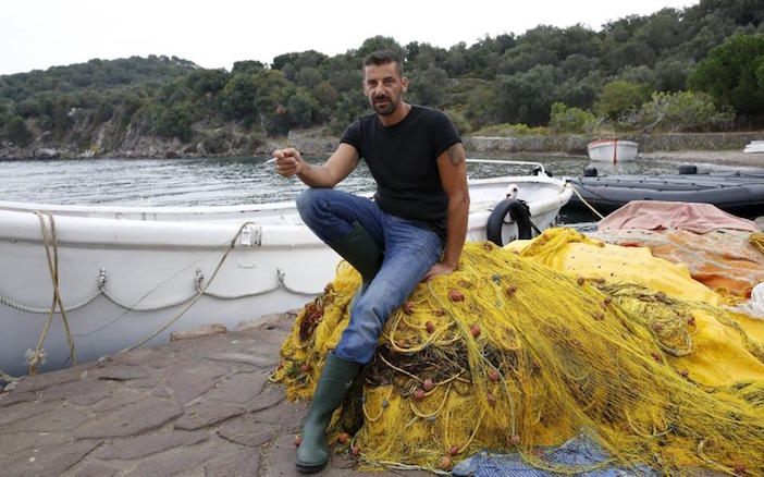 40-year-old fisherman Stratis Valiamos (Photo from Kathimerini)