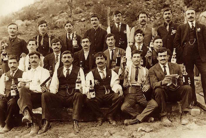 Cretan immigrants in Salt Lake City, UT showing off their guns and moonshine.