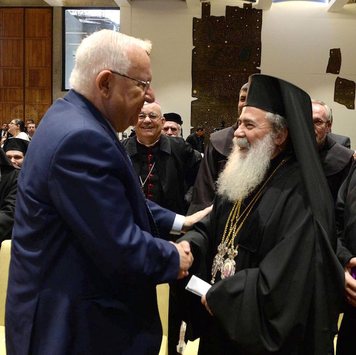 Israeli President Reuven Rivlin speaks with Greek Orthodox Patriarch of Jerusalem Theophilos III at his residence in Jerusalem in honor of the upcoming New Year, on December 27, 2016