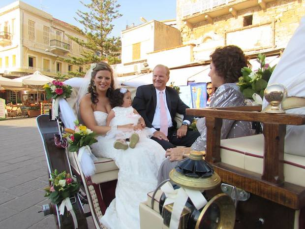 In traditional fashion, Stephanie, with her father and niece in hand, arrive at Trimartiri Catherdal