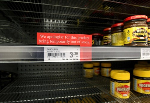 A sign alerting customers that a product is out of stock is placed in front of an empty shelve where Marmite is usually found at a supermarket in Auckland, New Zealand, Tuesday, March 20, 2012. The manufacturer, Sanitarium, announced this week it had run out of Marmite, the sticky black spread that fans adore and doubters think would be better used for axle grease. (AP Photo/New Zealand Herald, Sarah Ivey) NEW ZEALAND OUT, AUSTRALIA OUT
