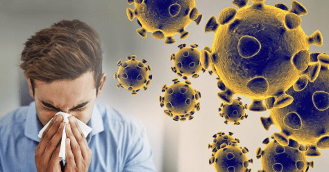 Virus cells, man sneezing