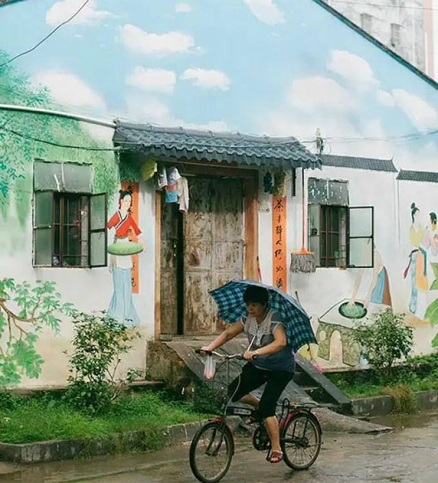 Chinees dorp bloeit helemaal op met deze muurschilderingen