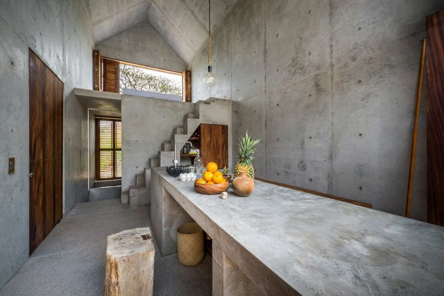 Interior-Space-of-Casa-Tiny-with-Concrete-Table-Kitchen