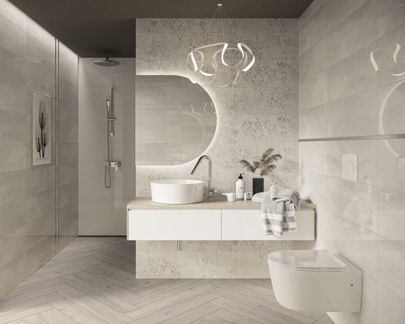 Jasna łazienka zprysznicem została zaaranżowana tak, bytworzyć funkcjonalne iprzestronne wnętrze.