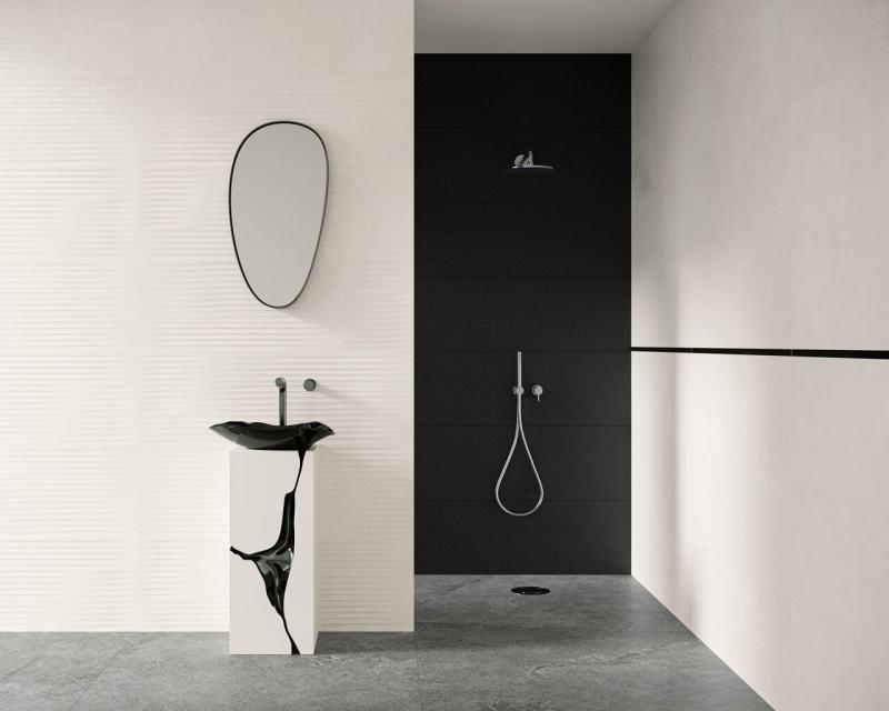 Oszczędność kolorów ielementów wyposażenia orazciekawe rozwiązania dekoracyjne tworzą minimalistyczną łazienkę.