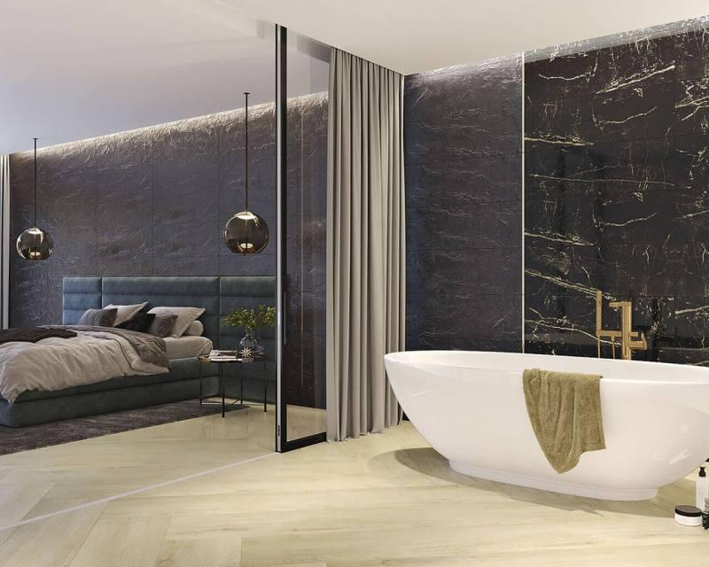 Łazienka może być oddzielona odsypialni zapomocą szklanej ściany, zasłony, czyozdobnego stelażu.