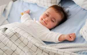 happy baby smiling while sleeping