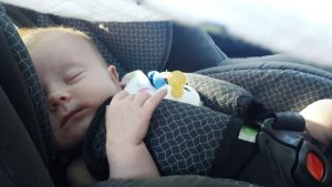 Baby in car seat, hopefully in middle seat