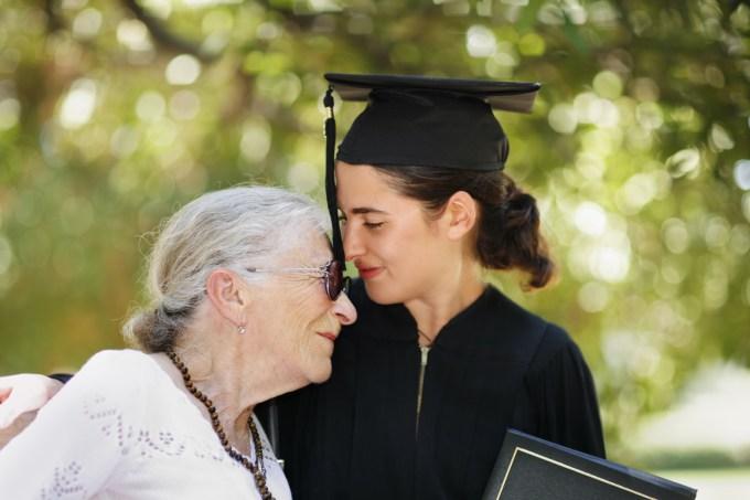 Happy graduate with grandmother celebrating graduation