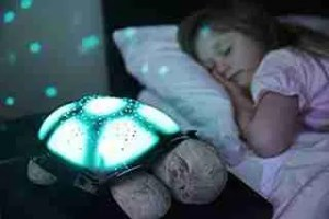 Cloud-b-Twilight-Turtle-Plush-Nightlight-beside-baby-sleep