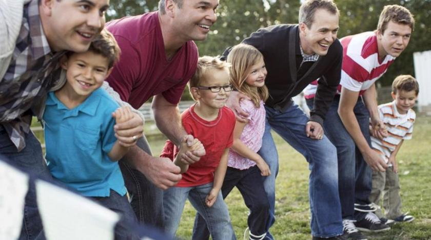 Families doing a three-legged race