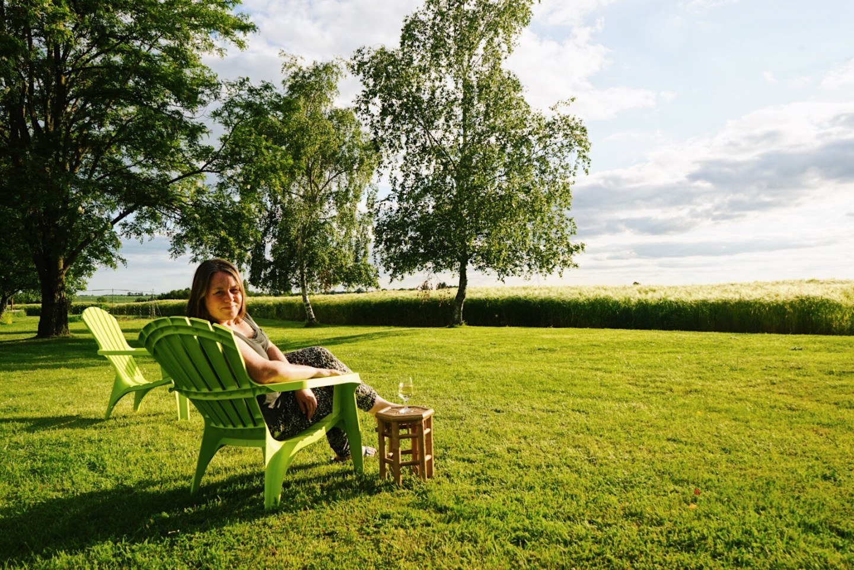 Sitting on the lawn in the sunshine at Gites de la Richarderie