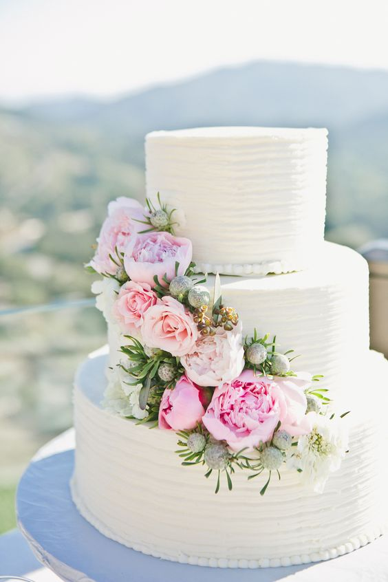 40 wedding cakes with roses you just can t resist A classic white wedding cake with peonies  And mountains in the background   Yes please