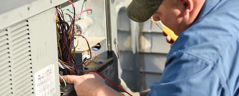 man repair an air conditioning unit