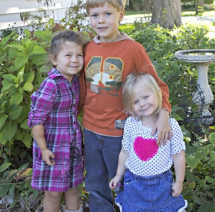 portrait of three children in front