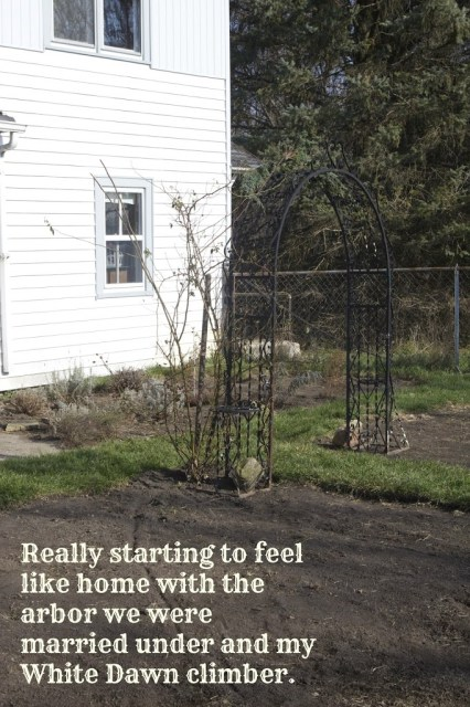 arbor behind house with descriptive text