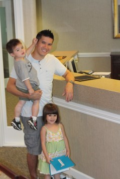 Dad with kids at dental office