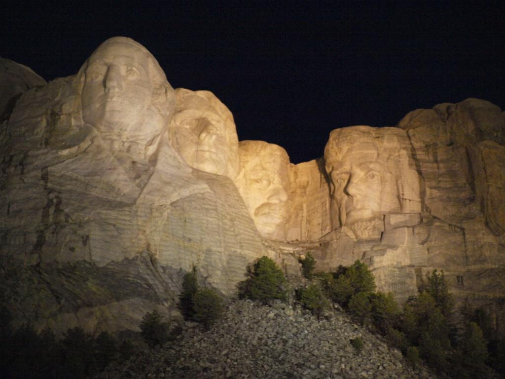 Mount Rushmore faces at night