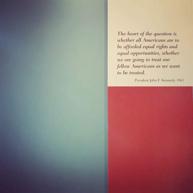 Quote from President John F. Kennedy about equality on a red, blue, and white background
