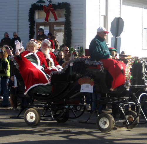 santa claus is coming to town during the holiday christmas carriage parade downtown parker colorado